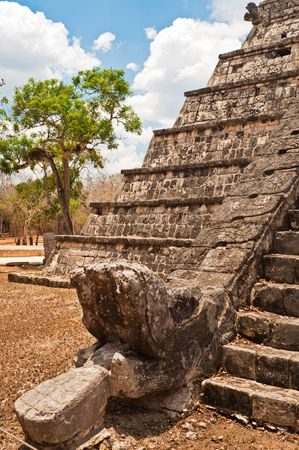 Feathered stone serpent at the foot of pyramid, Chichén Itzá, representing the head of Mayan god Kukulcan