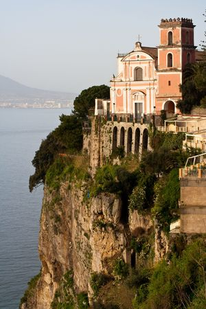 Amalfi Coast : church on a cliff directly above sea. Town Vico Equense Stock Photo