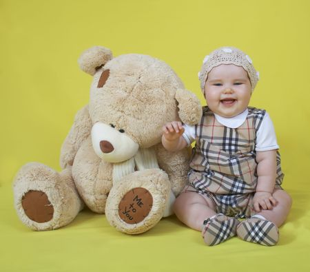 Little cute baby and teddy bear, smile