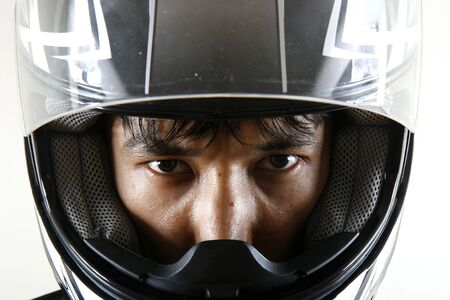 Strong eyes in bike helmet, isolated Stock Photo
