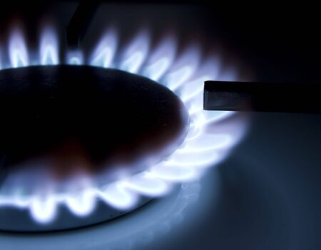 Bluish flames of a gas stove burner Stock Photo