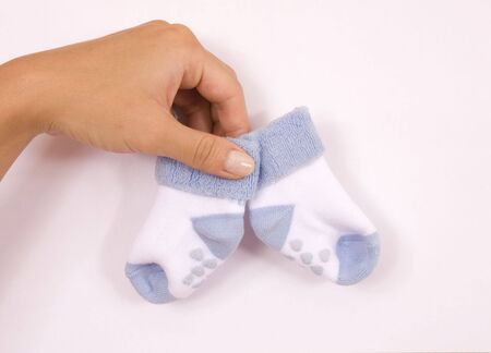 The little socks, child, small, wall, hand