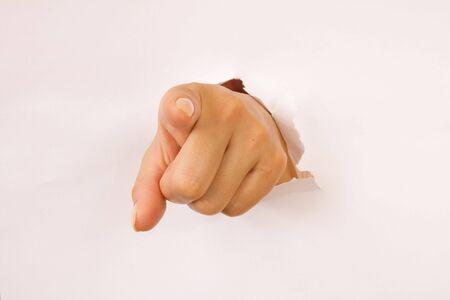 clawing: Popping mano di buco nella piana superficie bianca  Archivio Fotografico