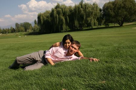 To fall in love, men and woman lying on green grass Stock Photo - 3717046