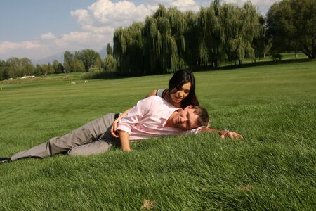 To fall in love, men and woman lying on green grass Stock Photo - 3717045