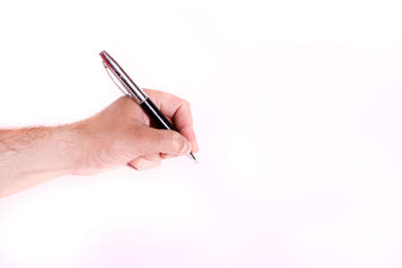 Male hand writing on white sheet of paper photo
