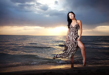 Asian beauty girl stay on the beach Stock Photo