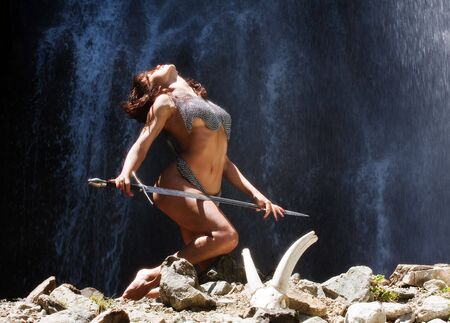 The woman warroir costs at falls with a sword