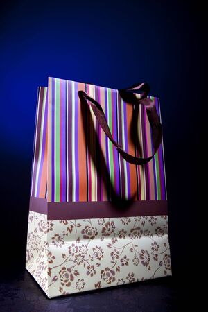 Bag, package for purchases from a paper on a blue background photo