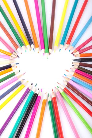 Colour pencils laid out in the form of heart