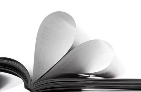 Pages in the book bent in the form of heart photo