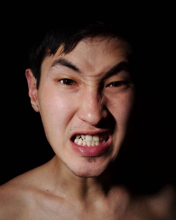 Obverse portrait of the Asian man, aggression, rage, emotions Stock Photo - 6596292