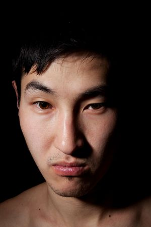 frowns: The obverse portrait of the young Asian man which frowns
