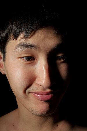 The obverse portrait of the young Asian man which smiles Stock Photo - 6596300