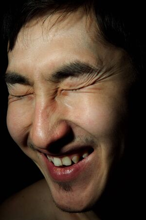 blindly: The young Asian guy blindly, laughs, an obverse portrait Stock Photo