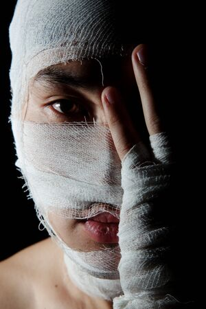 Obverse portrait of the young man which head is wound by bandage Stock Photo - 6611840