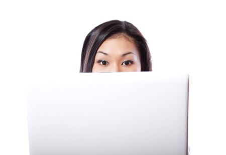 Protruding eyes of the young girl sitting at the laptop photo