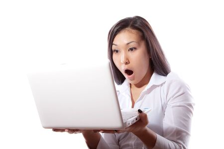The young attractive girl has control over the laptop Stock Photo