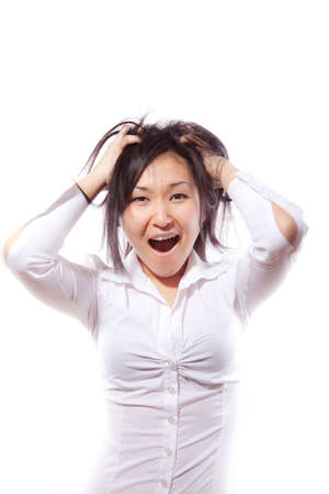 The attractive girl in a white shirt tears on itself hair with shout Stock Photo - 6998870