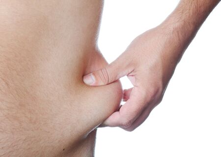The hand squeezes a skin part, showing excess weight