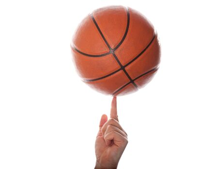 The isolated image of a hand and basketball ball on a white background