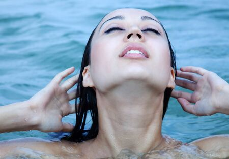 blindly: The girl has just come up from water, blindly does up hair