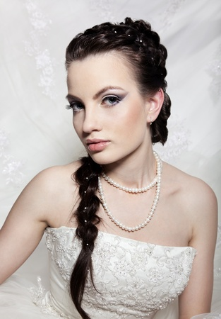 Very beautiful girl the bride, with the imposed make-up and a hairdress