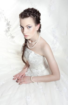 Very beautiful girl the bride, with the imposed make-up and a hairdress Stock Photo - 10421785