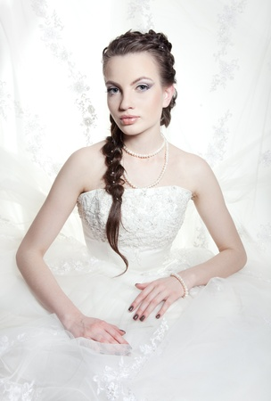 Very beautiful girl the bride, with the imposed make-up and a hairdress photo