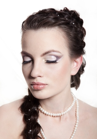 Portrait of the girl of the bride, with a make-up and a hairdress photo