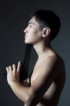 The guy with a pistol aims to itself in in a chin Stock Photo - 12941807