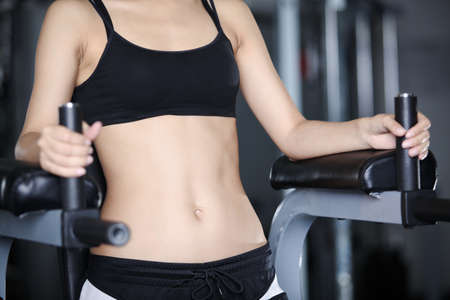 Figure of the girl on the machine for stomach exercises photo