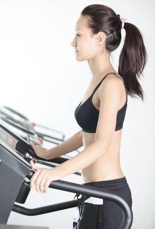 simulator: Asian girl slim body likes to run in the simulator Stock Photo