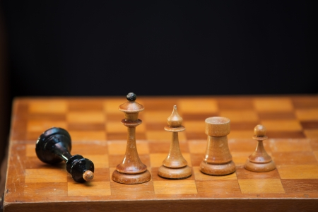 The figures placed on the board, defeated black king photo