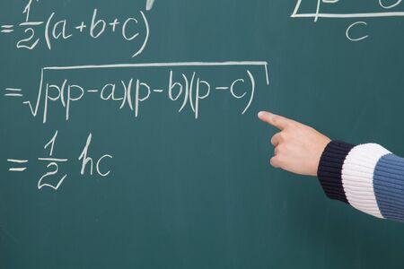 Prodigy: Trainee solve math problems written in chalk on the blackboard Zdjęcie Seryjne