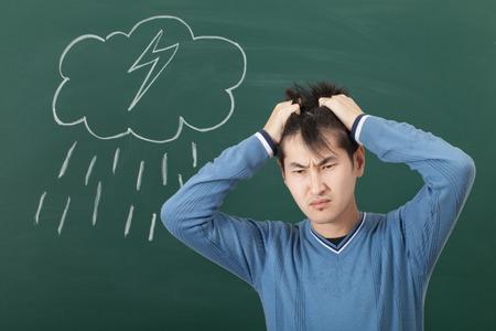 bad mood: A guy with a bad mood, drawn on a blackboard cloud and rain