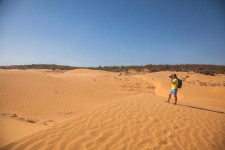 Traveller, one or more people in the desert, sand, dunes