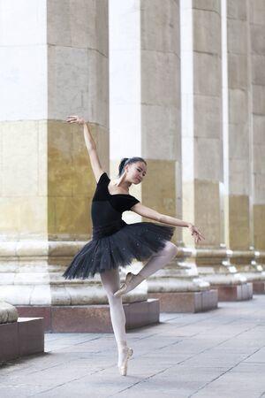 on tiptoes: Girl ballerina flats standing on tiptoes on the street