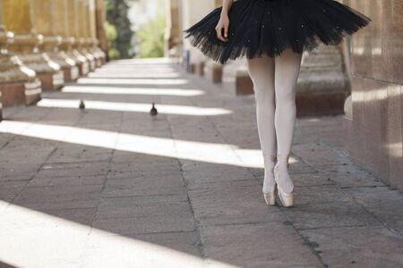 on tiptoes: Girl ballerina flats standing on tiptoes Stock Photo