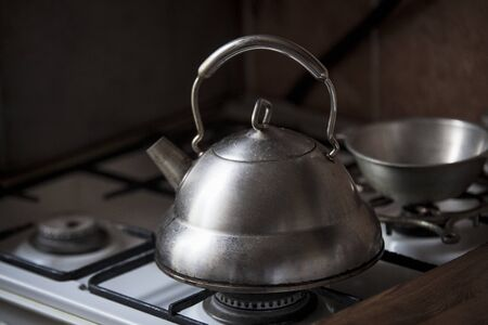 stovetop: The teapot costs on a gas ring Stock Photo