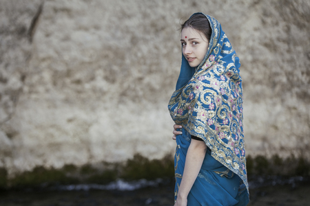 appearance: The girl of the European appearance poses in the Indian sari at Kaindy lake Stock Photo