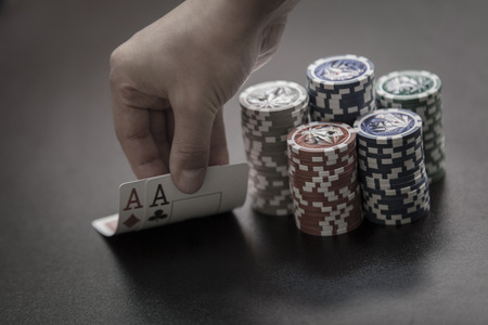 Man's hands show his winner hands, aces card