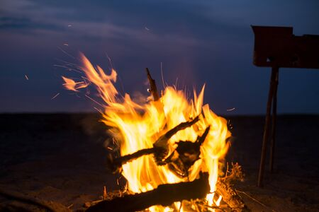 extinguishing: Fire on a beach, we have a rest, we fry a shish kebab
