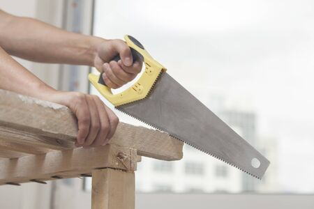Sawing by the hand saw of wooden whetstone