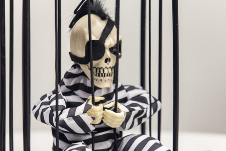 Skeleton toy in a prison