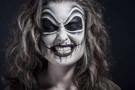 Halloween creative make up, smiling.