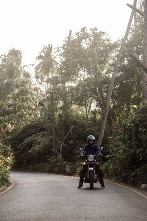 A Man On Motorcycle On Road in GOA village