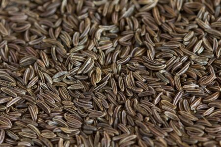 caraway: Caraway seeds on an old wooden table