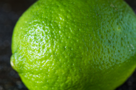 closely: lime on a black marble desk closely Stock Photo