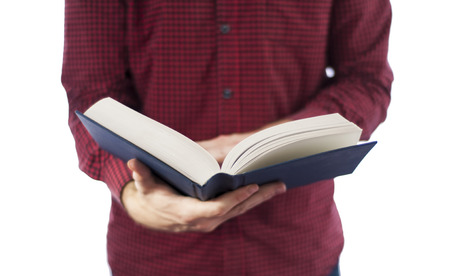holding bible: Man holding open book isolated on white Stock Photo